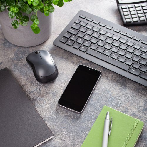 home office desk with keyboard computer smartphone notebook hous
